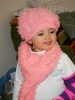 American child in Pink hat and scarf